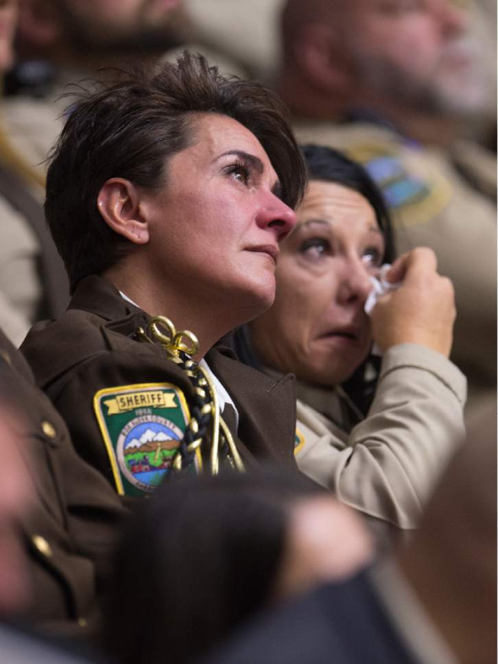 Leah Hogsten  |  The Salt Lake Tribune Those attending the funeral service for Utah Highway Patrol Trooper Eric Ellsworth react as Ellsworth's wife Janica and brother Mike express their love for him Wednesday, November 30, 2016 at the Dee Event Center in Ogden on the campus of Weber State. Ellsworth was hit by a car on the night of November 18, 2016 while trying to alert the driver of a semitrailer truck to go around a downed power line in Box Elder County. He died four days later.