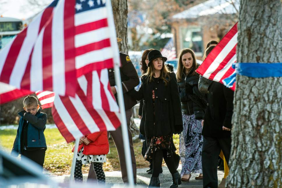 Chris Detrick  |  The Salt Lake Tribune Janica Ellsworth arrives with family and friends during the burial of Utah Highway Patrol Trooper Eric Ellsworth at Brigham City Cemetery Wednesday November 30, 2016. Ellsworth was hit by a car on the night of November 18, 2016 while trying to alert the driver of a semitrailer truck to go around a downed power line in Box Elder County. He died four days later.