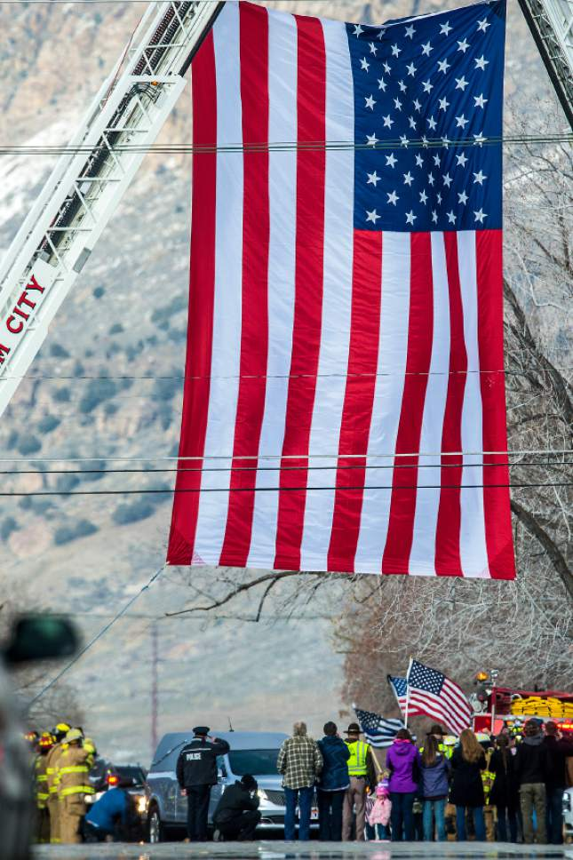 Chris Detrick  |  The Salt Lake Tribune The funeral procession for Utah Highway Patrol Trooper Eric Ellsworth arrives at Brigham City Cemetery Wednesday November 30, 2016. Ellsworth was hit by a car on the night of November 18, 2016 while trying to alert the driver of a semitrailer truck to go around a downed power line in Box Elder County. He died four days later.