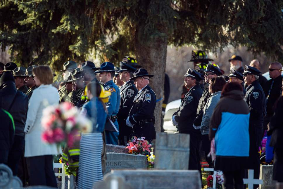 Chris Detrick  |  The Salt Lake Tribune Law enforcement officers listen during the burial of Utah Highway Patrol Trooper Eric Ellsworth at Brigham City Cemetery Wednesday November 30, 2016. Ellsworth was hit by a car on the night of November 18, 2016 while trying to alert the driver of a semitrailer truck to go around a downed power line in Box Elder County. He died four days later.