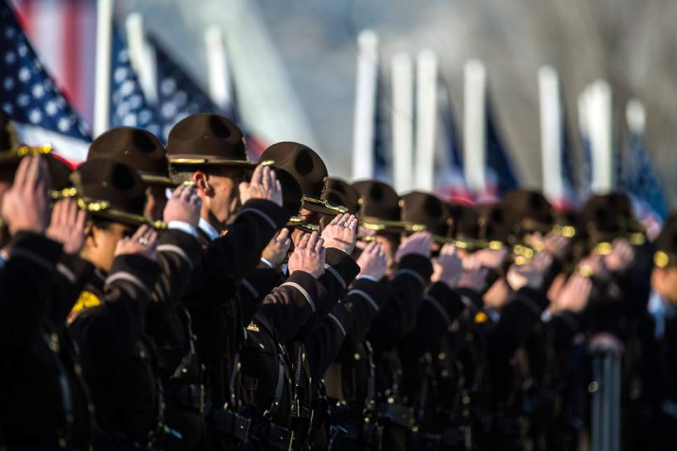 Chris Detrick  |  The Salt Lake Tribune Members of the Utah Highway Patrol salute as the casket of during the burial of Utah Highway Patrol Trooper Eric Ellsworth at Brigham City Cemetery Wednesday November 30, 2016. Ellsworth was hit by a car on the night of November 18, 2016 while trying to alert the driver of a semitrailer truck to go around a downed power line in Box Elder County. He died four days later.