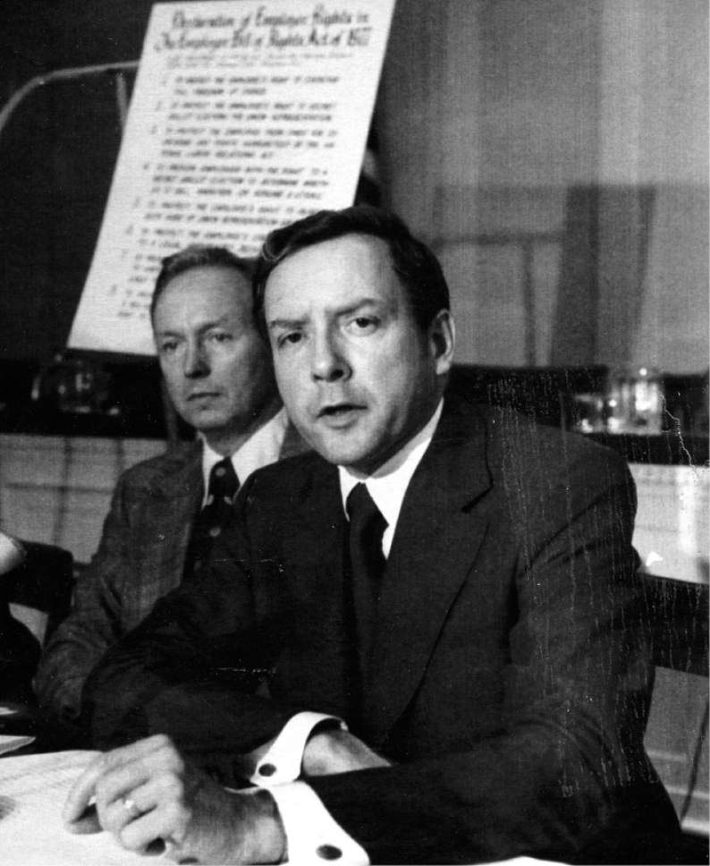 """Sen. Orrin Hatch, R-Utah, talks to reporters during a press conference in Washington Thursday. Hatch briefed newsmen on the """"Employee Bill of Rights Act of 1977"""", legislation which he introduced which would give employees the right of free choice to engage in or to refrain from collective bargaining. In background is Rep. John Erlenborn, R -Ill, who introduced a similar bill in the house. Credit: The Salt Lake Tribune Library"""