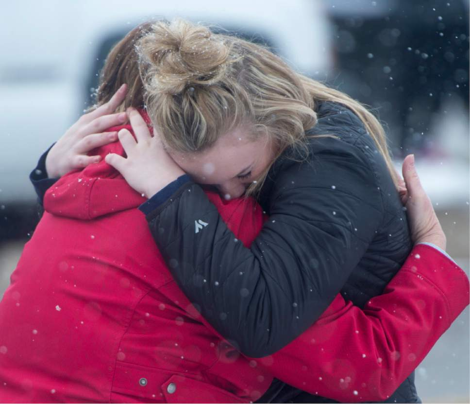 Rick Egan  |  The Salt Lake Tribune  DeAnne Bailey hugs her daughter Hannah Bailey as they wait for informant about De Anne's other daughter Halissa, at Mueller Park Jr High, after a reported shooting this morning, Thursday, December 1, 2016.