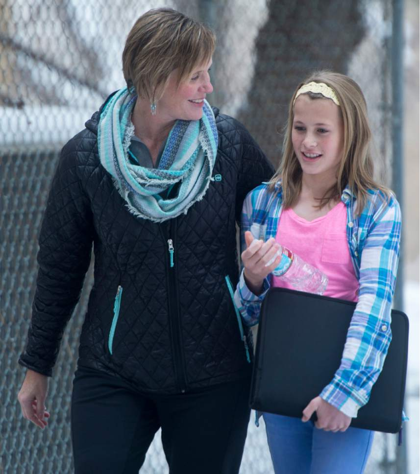 Rick Egan  |  The Salt Lake Tribune  Mary Ann Wilkinson walks with her daughter Sarah, a 7th grader student at Mueller Park Jr High, in Bountiful, where there was a shooting this morning, Thursday, December 1, 2016.