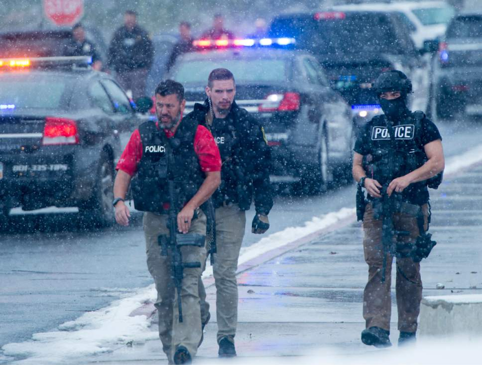 Rick Egan  |  The Salt Lake Tribune  Police officers leave Mueller Park Jr High, in Bountiful, after the shooting suspect was apprehended, Thursday, December 1, 2016.