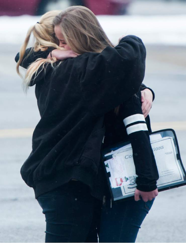 Rick Egan  |  The Salt Lake Tribune  Katie Christensen, hugs Seneca Zaugg, both students are in 9th grade at Mueller Park Jr. High, in Bountiful, where there was a shooting, Thursday, December 1, 2016.