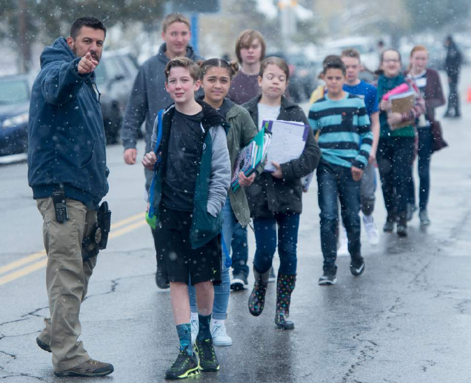 Rick Egan  |  The Salt Lake Tribune  A police man directs Mueller Park Jr. High, students to the church where their parents are waiting for them, as they are released from school, after a shooting at Mueller Park Jr. High, in Bountiful, Thursday, December 1, 2016.