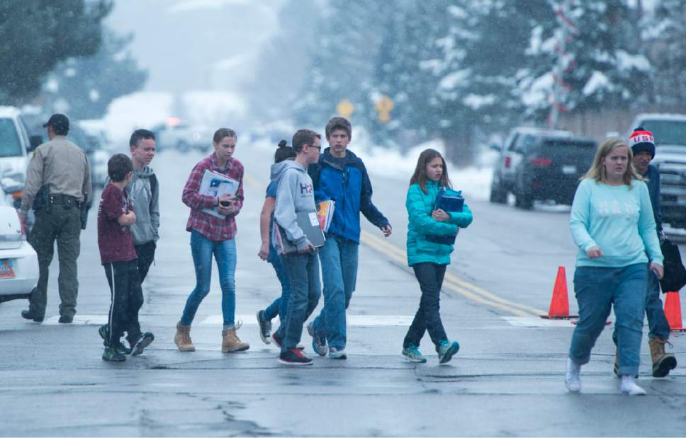 Rick Egan  |  The Salt Lake Tribune  Mueller Park Jr. High, students walk to the church where their parents are waiting for them, as they are released from school, after a shooting at Mueller Park Jr. High, in Bountiful, Thursday, December 1, 2016.