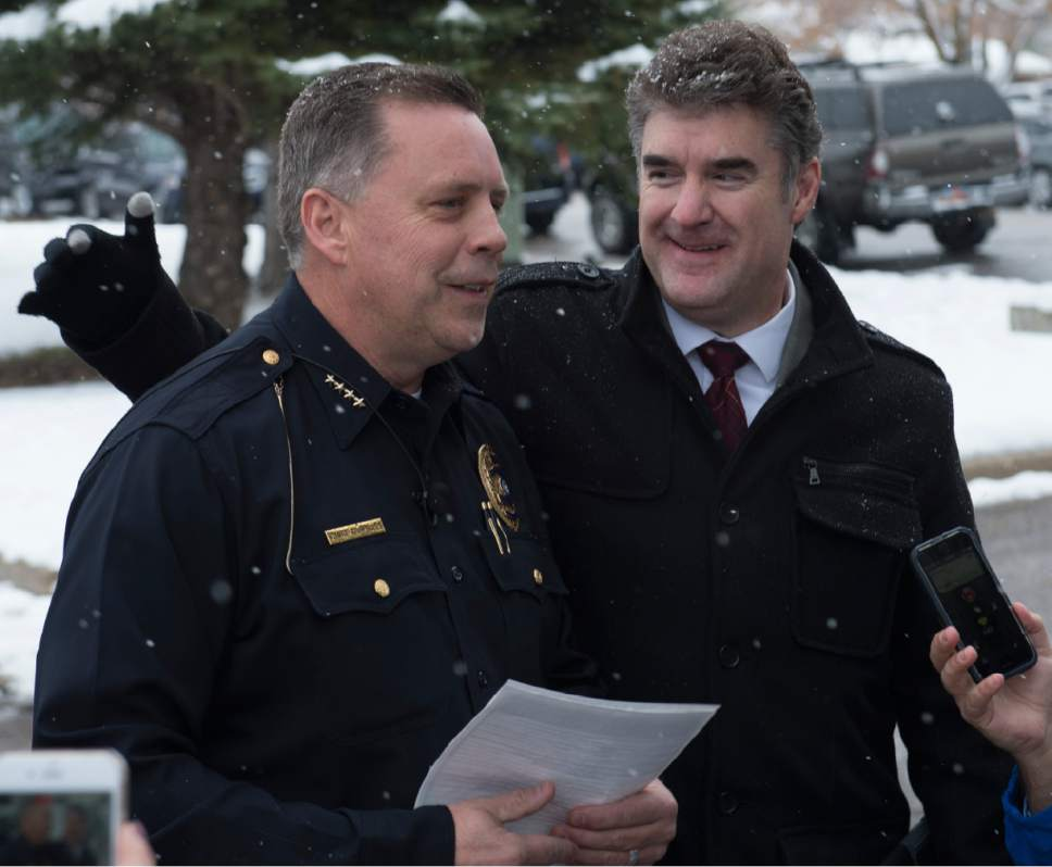 Rick Egan  |  The Salt Lake Tribune  Bountiful Police Chief Tom Ross  gets a pat on the back fro Chris Williams, Davis School District, during a press conference after a shooting at Mueller Park Jr. High, in Bountiful, Thursday, December 1, 2016.