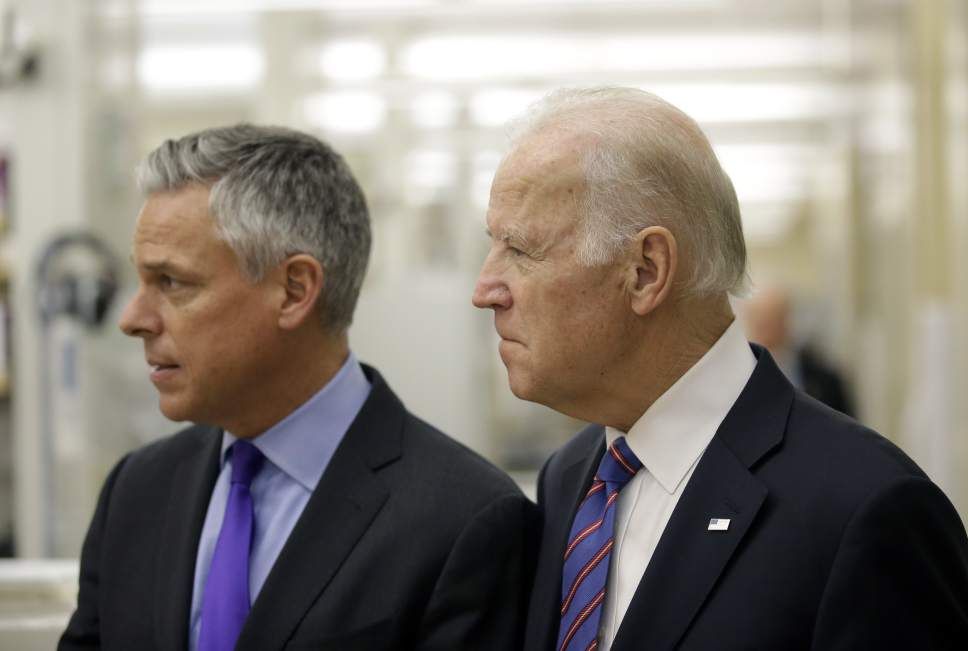 "Vice President Joe Biden walks with former Utah Gov. Jon M. Huntsman during a tour of the research lab at the Huntsman Cancer Institute Friday, Feb. 26, 2016, in Salt Lake City, as part of the White House's cancer ""moonshot,"" an ambitious effort to double the rate of progress toward curing cancer and ramp up federally funded research on the disease. Working toward a cure for cancer is personal for Biden, whose 46-year-old son, former Delaware state Attorney General Beau Biden, died from brain cancer in May. (AP Photo/Rick Bowmer, Pool)"