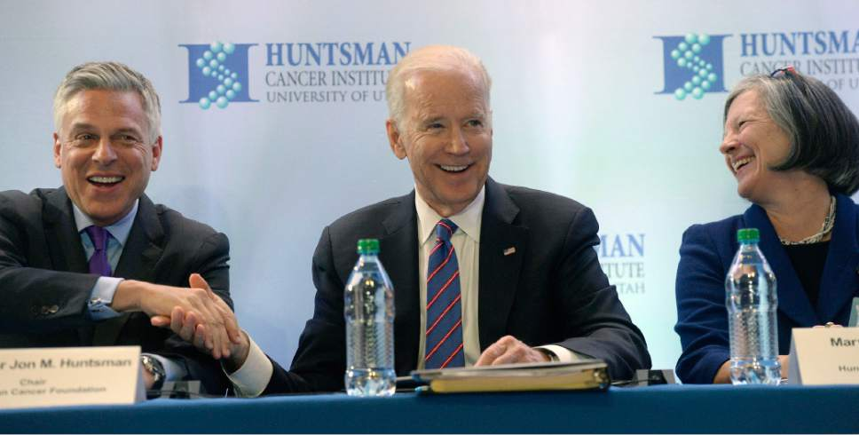 Al Hartmann  |  The Salt Lake Tribune Vice President Joe Biden, center, speaks at a roundtable discussion with former Utah Governor Jon M. Huntsman, Chair of the Hunstsman Cancer Foundation, left, and Huntsman Cancer Institute Director and CEO Mary Beckerle, right, after touring the Huntsman Cancer Institute in Salt Lake City Friday, February 26.