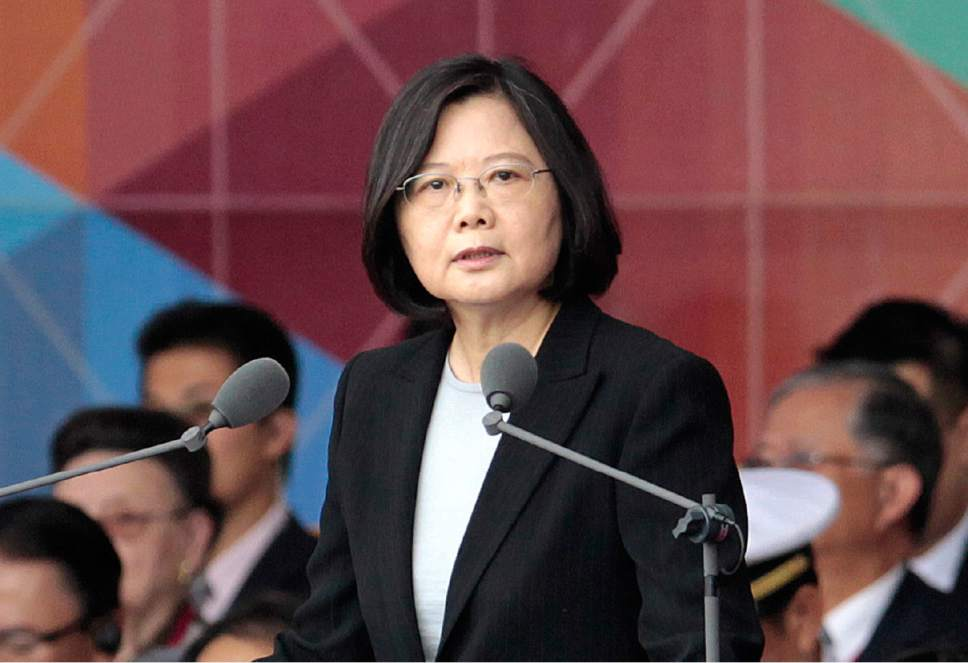 """FILE - In this Oct. 10, 2016, file photo, Taiwan's President Tsai Ing-wen delivers a speech during National Day celebrations in front of the Presidential Building in Taipei, Taiwan. President-elect Donald Trump spoke Dec. 2, with the president of Taiwan, a self-governing island the U.S. broke diplomatic ties with in 1979. It is highly unusual, perhaps unprecedented, for a U.S. president or president-elect to speak directly with a Taiwanese leader and will be sure to anger China. Washington has pursued a so-called """"one China"""" policy since 1979 when it shifted diplomatic recognition of China from the government in Taiwan to the communist government on the mainland. (AP Photo/Chiang Ying-ying, File)"""