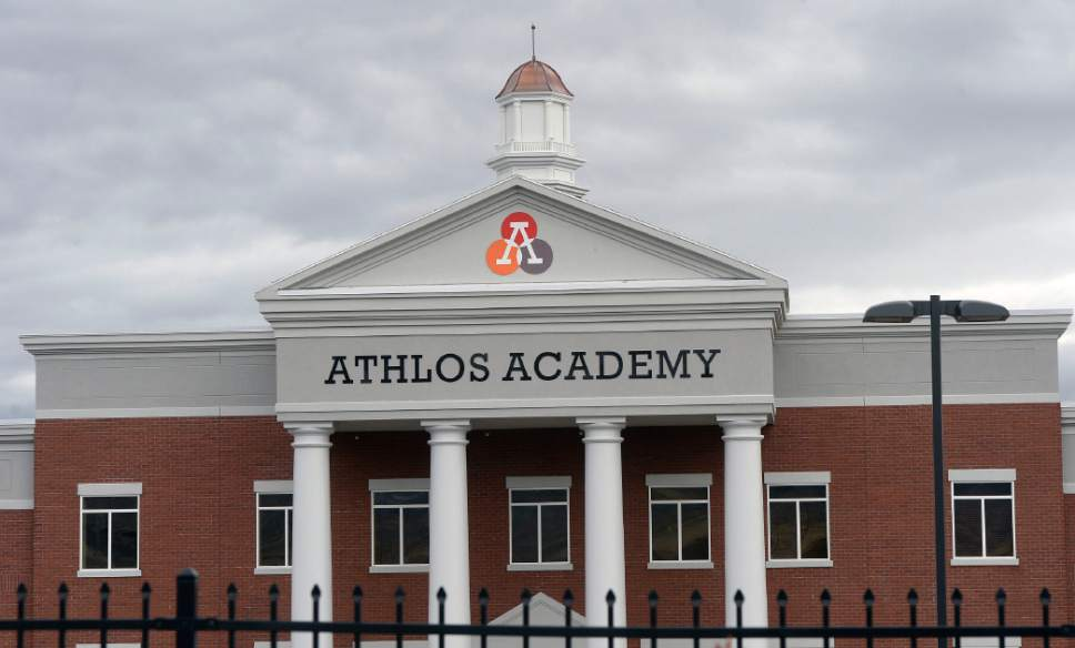 Al Hartmann  |  The Salt Lake Tribune Utah Rep. Rich Cunningham is accusing Athlos Academy of Utah of violating Utah law, which requires public schools to open a bid process before sending taxpayer dollars to building costs. Athlos' private parent company built the school's Herriman location, which Athlos now leases.