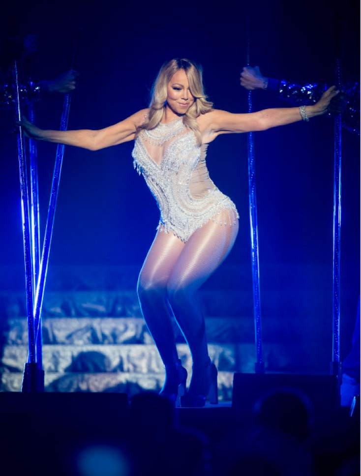 FILE - In this Tuesday, March 15, 2016, file photo,  Mariah Carey performs onstage during her European tour at the SSE Hydro in Glasgow, Scotland.  (Danny Lawson/PA via AP, File)