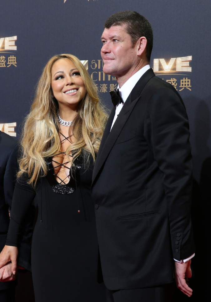 FILE - In this Oct. 27, 2015 file photo, singer Mariah Carey, left, and Australian businessman James Packer attend the opening ceremony for the Studio City project in Macau.  (AP Photo/Kin Cheung, File)