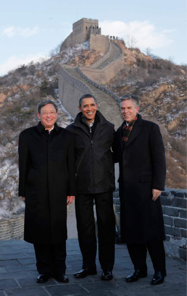 Charles Dharapak  |  Associated Press file photo  U.S. President Barack Obama, center, poses with China's Ambassador to the United States Zhou Wenzhong, left, and the U.S. Ambassador to China Jon Hunstman as he tours the Great Wall in Badaling, China.
