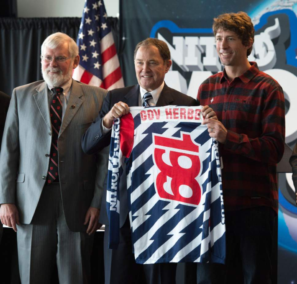 Steve Griffin     The Salt Lake Tribune  University of Utah President David Pershing stands withTravis Pastrana, Nitro World Games co-founder, right, as Gov. Gary R. Herbert, center,  holds up a souvenir jersey following a press conference announcing the inaugural Nitro World Games at the University of Utah's Rice-Eccles Stadium in Salt Lake City, Monday, December 7, 2015. The event will be held at Rice-Eccles Stadium July 16, 2016.