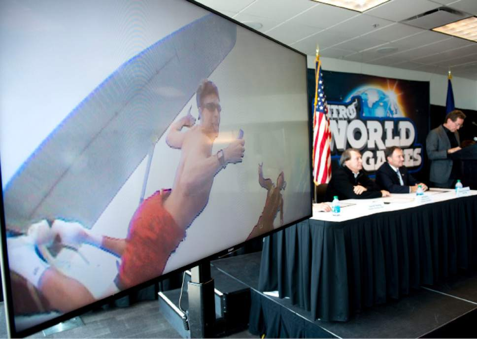 Steve Griffin     The Salt Lake Tribune  A video of Travis Pastrana, Nitro World Games co-founder,  jumping out of an airplane with no parachute plays during a press conference announcing the inaugural Nitro World Games at the University of Utah's Rice-Eccles Stadium in Salt Lake City, Monday, December 7, 2015. The event will be held at Rice-Eccles Stadium July 16, 2016.