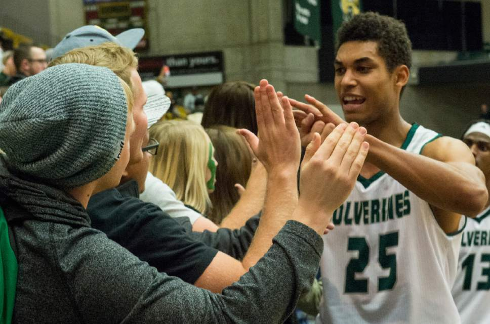 Rick Egan     The Salt Lake Tribune  Utah Valley Wolverines guard Kenneth Ogbe (25) high-fives fans after the Wolverines defeated the Texas-San Antonio Roadrunners, 75-71 at the UCCU Center, in Orem, Saturday, December 3, 2016.
