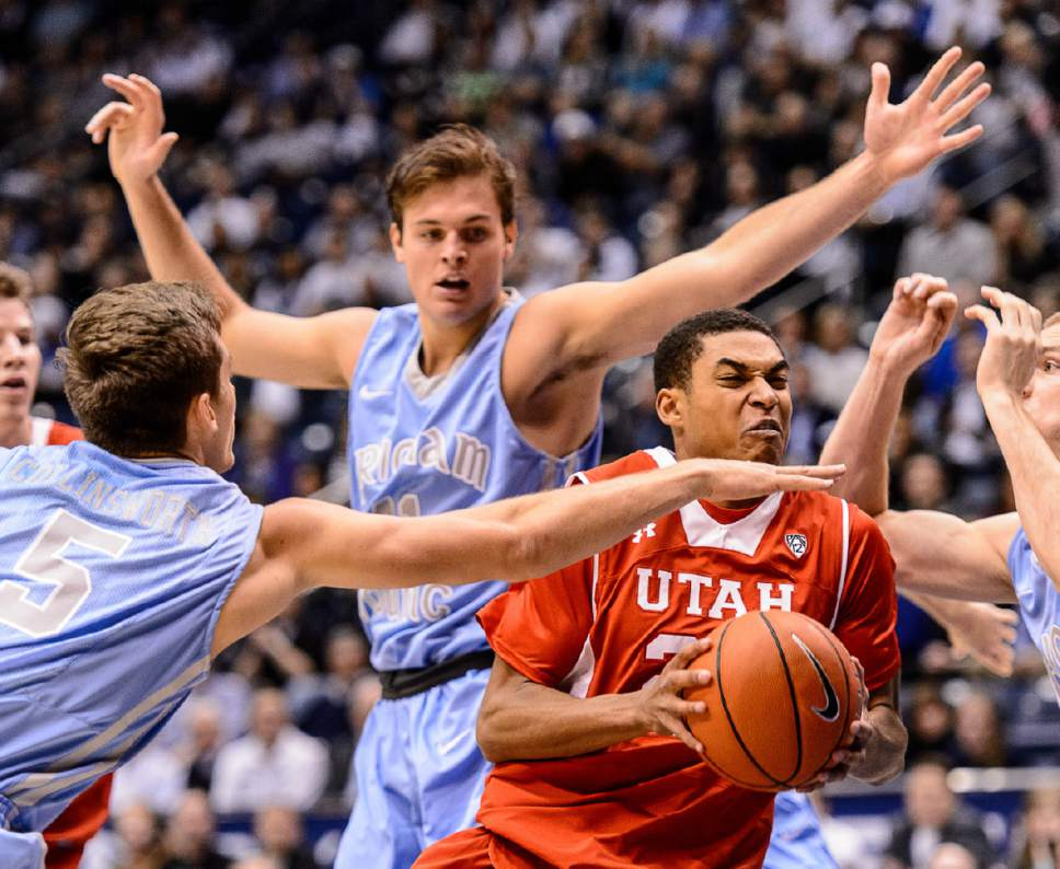 Trent Nelson     The Salt Lake Tribune Utah Utes guard Kenneth Ogbe (25) drives to the basket as BYU hosts Utah, college basketball at the Marriott Center in Provo, Wednesday December 10, 2014.