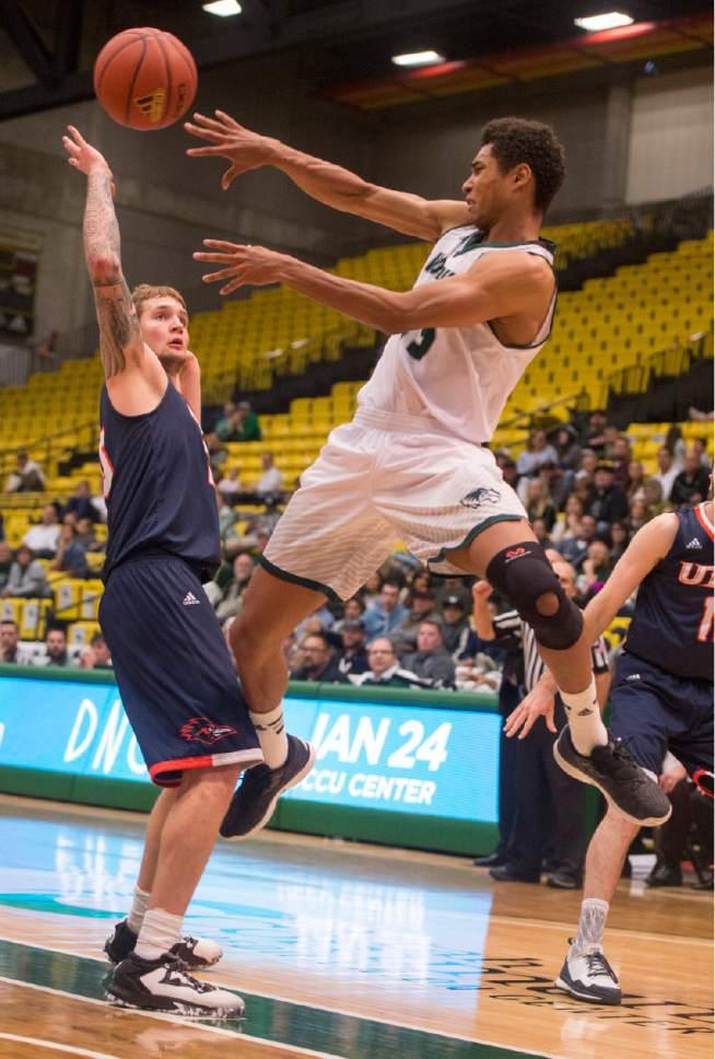 Rick Egan     The Salt Lake Tribune  Utah Valley Wolverines guard Kenneth Ogbe (25) tosses a pass, in basketball action, Utah Valley Wolverines vs. Texas-San Antonio Roadrunners, at the UCCU Center, in Orem, Saturday, December 3, 2016.