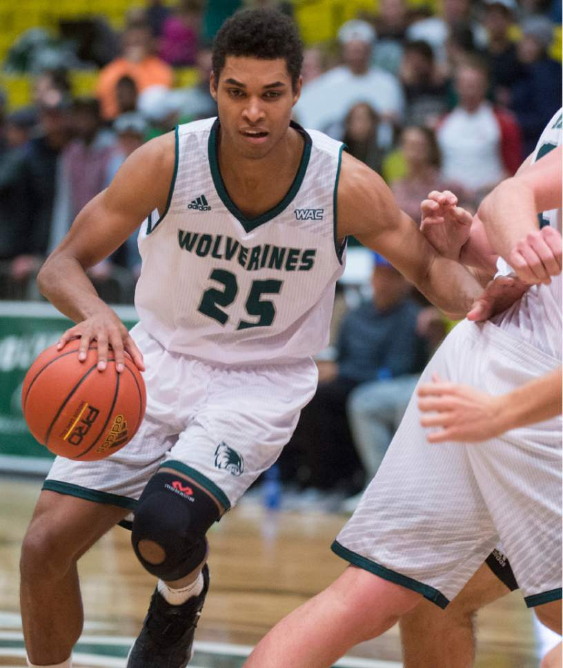 Rick Egan     The Salt Lake Tribune  Utah Valley Wolverines guard Kenneth Ogbe (25) takes the ball inside for the Wolverines, in basketball action, Utah Valley Wolverines vs. the Texas-San Antonio Roadrunners, at the UCCU Center, in Orem, Saturday, December 3, 2016.