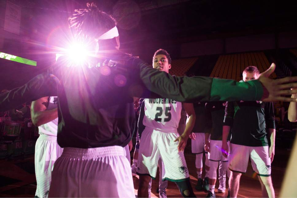 Rick Egan     The Salt Lake Tribune  Utah Valley Wolverines guard Kenneth Ogbe (25) is greeted by Wolverine guard Ivory Young, as he takes the court during player introductions, before theUtah Valley Wolverines faced the Texas-San Antonio Roadrunners, at the UCCU Center, in Orem, Saturday, December 3, 2016.