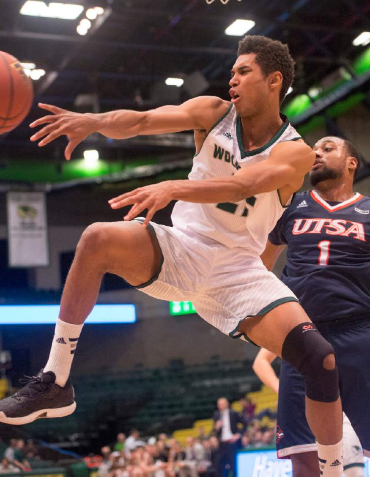 Rick Egan     The Salt Lake Tribune  Utah Valley Wolverines guard Kenneth Ogbe (25) tosses a pass under the hoop, in basketball action, Utah Valley Wolverines vs. the Texas-San Antonio Roadrunners, at the UCCU Center, in Orem, Saturday, December 3, 2016.