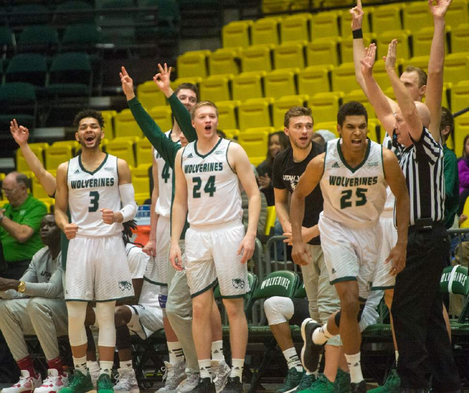 Rick Egan     The Salt Lake Tribune  The Wolverine bench reacts as Utah Valley Wolverines guard Kenneth Ogbe (25) hits a big three- point shot in teh second half, in basketball action Utah Valley Wolverines vs. the Texas-San Antonio Roadrunners, in Orem, Saturday, December 3, 2016.