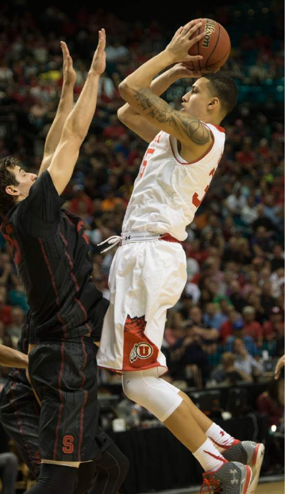 Rick Egan     The Salt Lake Tribune  Utah Utes guard Kenneth Ogbe (25) shoots over Stanford Cardinal forward Rosco Allen (25), in Pac-12 Basketball Championship action Utah vs. Stanford, at the MGM Arena, in Las Vegas, Thursday, March 12, 2015.