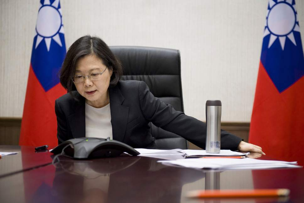 In this Friday, Dec. 2, 2016 photo released by Taiwan Presidential Office Saturday, Dec. 3, 2016, Taiwan's President Tsai Ing-wen speaks with U.S. President-elect Donald Trump through a speaker phone in Taipei, Taiwan. (Taiwan Presidential Office via AP)