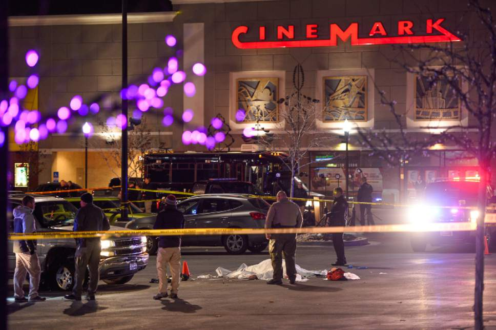 Francisco Kjolseth | The Salt Lake Tribune The body of a male suspect lies in the parking lot of the Cinemark in American Fork where he was shot at by police following brief pursuit on Sunday night, Dec. 4, 2014. Police said he may have died from a self-inflicted gunshot. The suspect is believed to have just shot and killed a woman in her car by a Walmart nearby.