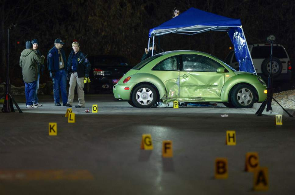 Francisco Kjolseth | The Salt Lake Tribune Multiple bullet holes speckle the side of a VW in the far end of the Walmart parking lot, where a woman was shot and killed on Sunday night, Dec. 4, 2016. The suspect was soon pursued to the nearby Cinemark, where officers fired at the suspect when he refused to drop his weapon. The supect died at the scene, but police say he may have shot himself.