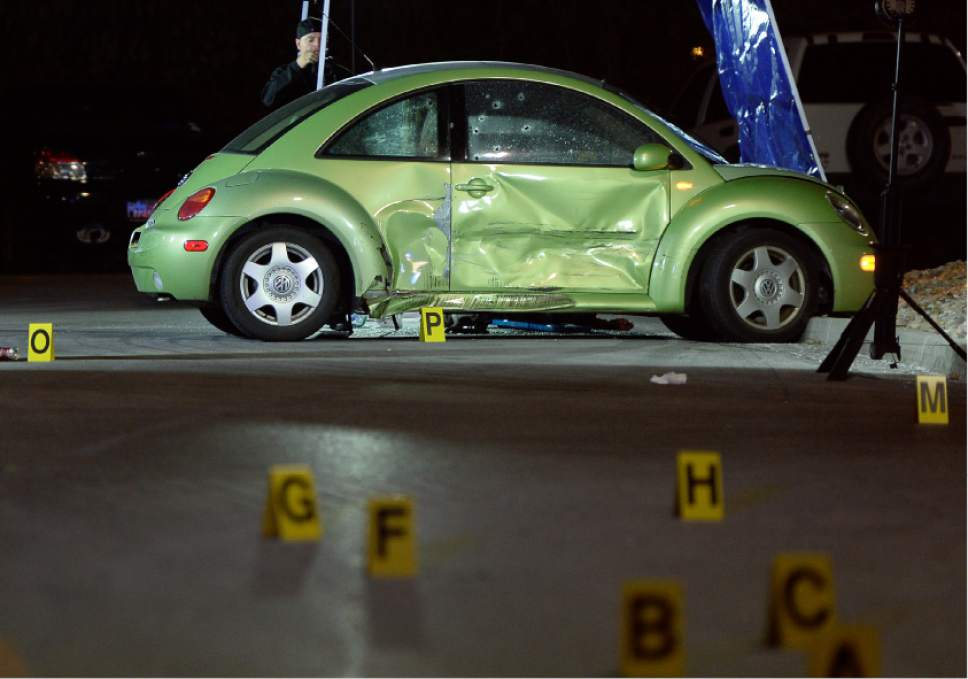 Francisco Kjolseth | The Salt Lake Tribune Multiple bullet holes speckle the side of a VW in the far end of the Walmart parking lot, where a woman was shot and killed on Sunday night, Dec. 4, 2016. The suspect was soon pursued to the nearby Cinemark where officers fired at the suspect when he refused to drop his weapon. The suspect died at the scene, but may have shot himself, police said.