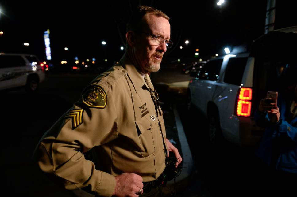Francisco Kjolseth | The Salt Lake Tribune Sergeant Spencer Cannon of the Utah County Sheriff's office gives an update at the scene of a fatal shooting near Cinemark in American Fork on Sunday, Dec. 4, 2016. The suspect allegedly fled from a Walmart nearby after shooting and killing a woman in her car.  Following a brief pursuit by police to the Cinemark, officers fired at the suspect when he refused to drop his weapon.