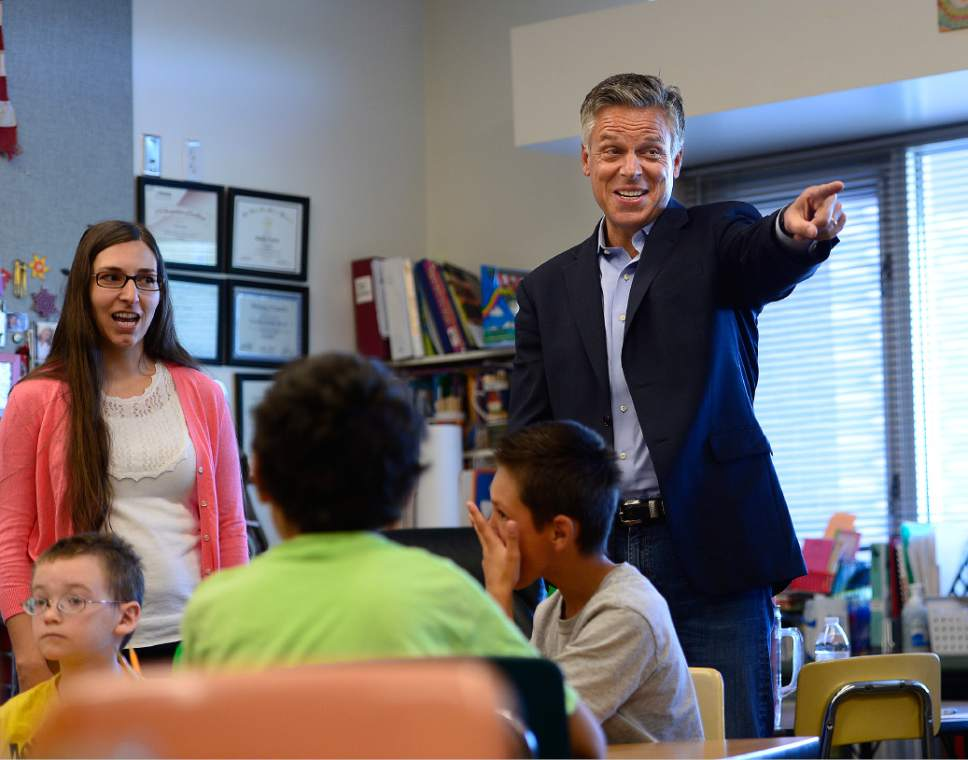 Scott Sommerdorf   |  The Salt Lake Tribune Jon M. Huntsman, Jr. jokes with students as he helped deliver teaching materials to Melody Francis' 4th grade classroom at Rose Park Elementary in association with Chevron's 2014 Fuel Your School Program, Wednesday, september 3, 2014. Huntsman has been U.S. Ambassador to China and Utah's Governor and is currently a Chevron Board of Directors Member. Teacher Melody Francis is at far left.