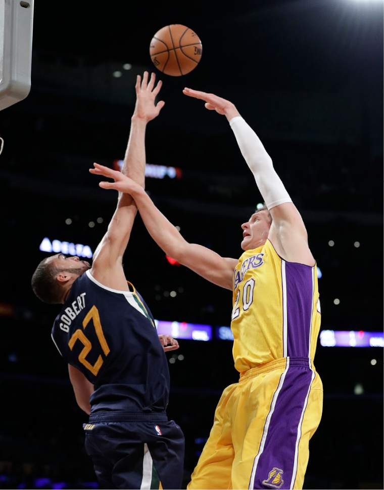 Los Angeles Lakers' Timofey Mozgov, right, of Russia, puts up a shot against Utah Jazz's Rudy Gobert during the first half of an NBA basketball game, Monday, Dec. 5, 2016, in Los Angeles. (AP Photo/Jae C. Hong)