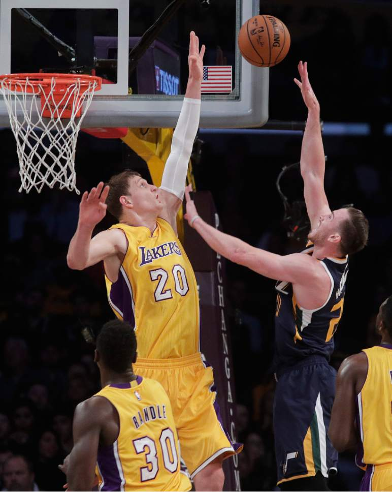 Utah Jazz's Gordon Hayward, right, is defended by Los Angeles Lakers' Timofey Mozgov, of Russia, during the first half of an NBA basketball game Monday, Dec. 5, 2016, in Los Angeles. (AP Photo/Jae C. Hong)