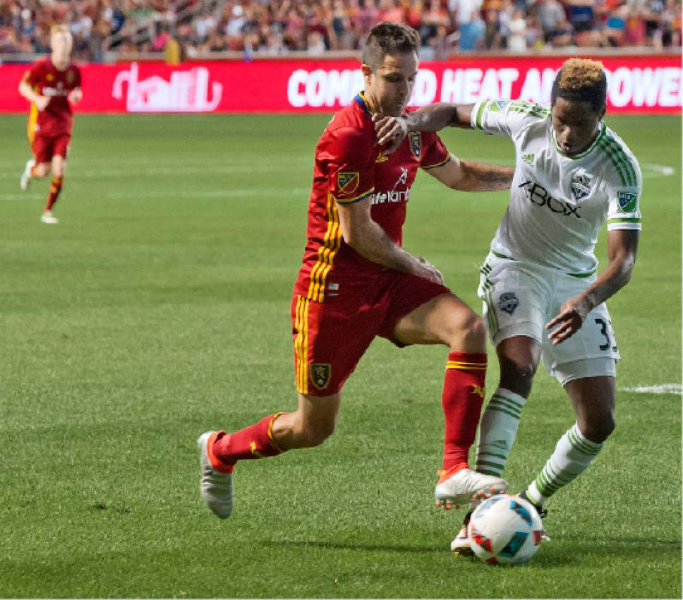 Michael Mangum  |  Special to the Tribune  Seattle Sounders defender Joevin Jones (33) and Real Salt Lake forward Burrito Martinez (7) jockey for posession during their U.S. Open Cup match at Rio Tinto Stadium in Sandy, UT on Tuesday, June 28th, 2016. The match ended in a 1-1 draw with Seattle advancing after winning in a penalty kick shootout.