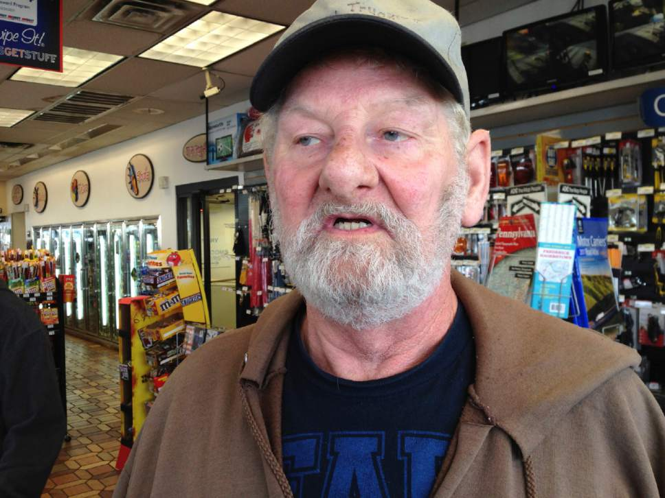 Truck driver George Lafferty of Henry, Illinois, talks at a truck stop along Interstate 81 in Hagerstown, Md., Wednesday, Dec. 7, 2016. He says he supports Congress suspending regulations requiring truckers to take two nights off to rest after a work week of up to 75 hours. He says  the government shouldn't be able to tell people when to sleep. (AP Photo/David Dishneau)
