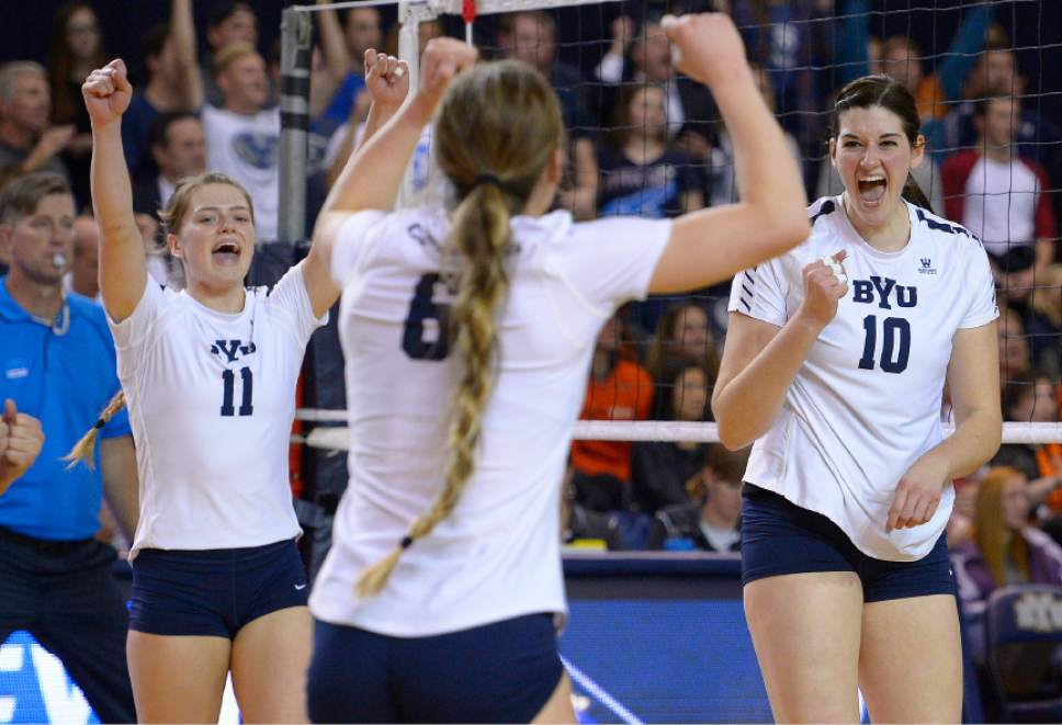 Leah Hogsten  |  The Salt Lake Tribune BYU outside hitter Lacy Haddock (11) and BYU middle blocker Amy Boswell (10) celebrate BYU setter Lyndie Haddock (6) kill. Brigham Young University women's volleyball team defeated Princton 3-0 during the first round of the NCAA tournament Friday, December 2, 2016 on the campus of Brigham Young University.