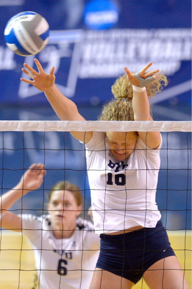 Leah Hogsten  |  The Salt Lake Tribune BYU middle blocker Amy Boswell (10) tries to make the block. Brigham Young University women's volleyball team defeated Princeton 3-0 during the first round of the NCAA tournament Friday, December 2, 2016 on the campus of Brigham Young University.