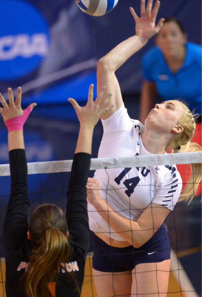 Leah Hogsten  |  The Salt Lake Tribune BYU outside hitter Mckenna Miller (14) fires one over the net. Brigham Young University women's volleyball team defeated Princton 3-0 during the first round of the NCAA tournament Friday, December 2, 2016 on the campus of Brigham Young University.