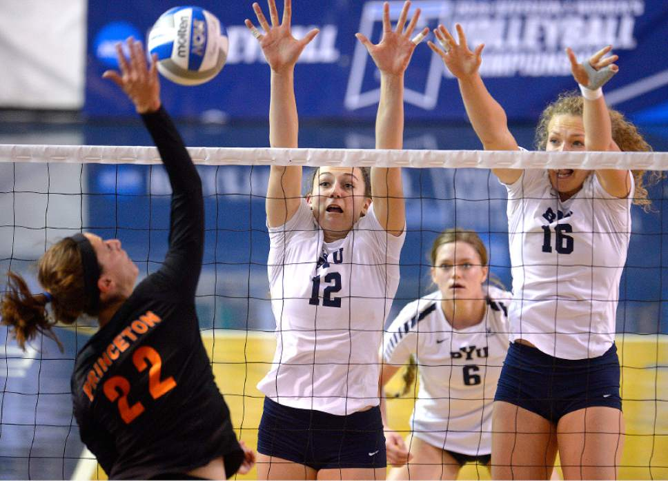Leah Hogsten  |  The Salt Lake Tribune BYU outside hitter Veronica Jones-Perry (12) and BYU middle blocker Whitney Young Howard (16) aim to block Princeton outside hitter Cara Mattaliano (22). Brigham Young University women's volleyball team defeated Princeton 3-0 during the first round of the NCAA tournament Friday, December 2, 2016 on the campus of Brigham Young University.