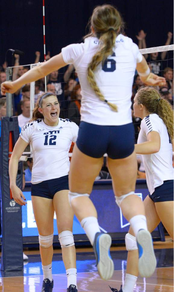Leah Hogsten  |  The Salt Lake Tribune BYU celebrates the win. Brigham Young University women's volleyball team defeated Princton 3-0 during the first round of the NCAA tournament Friday, December 2, 2016 on the campus of Brigham Young University.