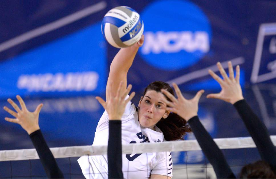 Leah Hogsten  |  The Salt Lake Tribune BYU middle blocker Amy Boswell (10) slams the ball over the net. Brigham Young University women's volleyball team defeated Princton 3-0 during the first round of the NCAA tournament Friday, December 2, 2016 on the campus of Brigham Young University.