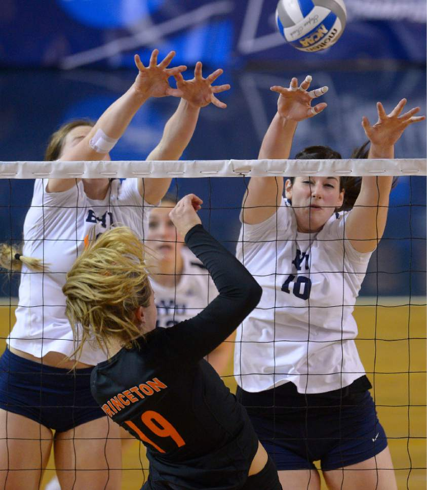 Leah Hogsten  |  The Salt Lake Tribune BYU outside hitter Hannah Robison (20) and BYU middle blocker Amy Boswell (10) try to make the stop. Brigham Young University women's volleyball team defeated Princton 3-0 during the first round of the NCAA tournament Friday, December 2, 2016 on the campus of Brigham Young University.