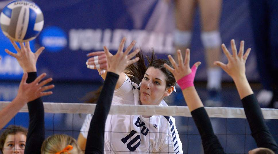Leah Hogsten  |  The Salt Lake Tribune BYU middle blocker Amy Boswell (10) slams the ball over the net. Brigham Young University women's volleyball team defeated Princeton 3-0 during the first round of the NCAA tournament Friday, December 2, 2016 on the campus of Brigham Young University.