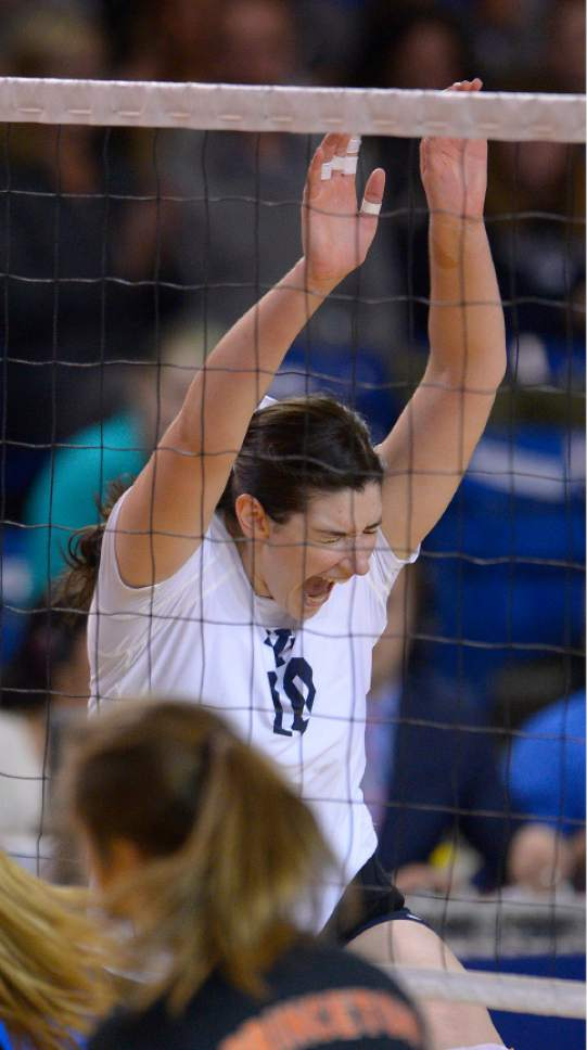 Leah Hogsten  |  The Salt Lake Tribune BYU middle blocker Amy Boswell (10) celebrates a kill. Brigham Young University women's volleyball team defeated Princeton 3-0 during the first round of the NCAA tournament Friday, December 2, 2016 on the campus of Brigham Young University.