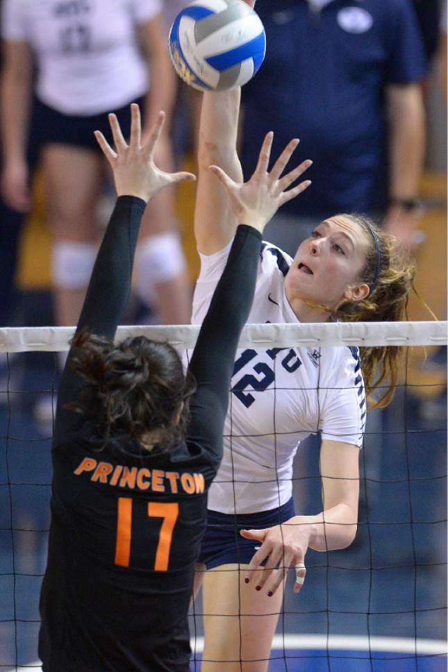 Leah Hogsten  |  The Salt Lake Tribune BYU outside hitter Veronica Jones-Perry (12) fires one over Princeton middle blocker Maggie O'Connell (17). Brigham Young University women's volleyball team defeated Princeton 3-0 during the first round of the NCAA tournament Friday, December 2, 2016 on the campus of Brigham Young University.